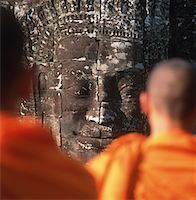 Buddhist monks by face sculpture at Angkor Wat Stock Photo - Premium Rights-Managednull, Code: 832-03723888