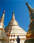 Man at the gilded pagoda of Shwe Dagon, Rangoon, Myanmar Stock Photo - Premium Rights-Managed, Artist: IIC, Code: 832-03724135