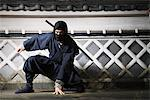 Masked Ninja Crouching By Wall Stock Photo - Premium Rights-Managed, Artist: Aflo Relax, Code: 859-03730703