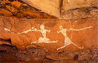 prehistoric - Libya, Fezzan, Jebel Akakus. A pair of running figures painted onto the walls of Uan Muhuggiag, one of Wadi Teshuinat's caves. Stock Photo - Premium Rights-Managednull, Code: 862-03731755