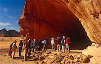 prehistoric - Libya, Fezzan, Jebel Akakus. Tourists gather at the mouth of Uan Amil, one of Wadi Teshuinat's caves. Stock Photo - Premium Rights-Managednull, Code: 862-03731756