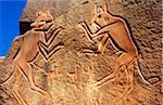Libya, Fezzan, Messak Settafet. A petroglyph of felines, known as the 'dancing cats' -stands by a ledge high above Wadi Mathendusch. Stock Photo - Premium Rights-Managed, Artist: AWL Images, Code: 862-03731770