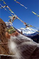 Nepal, Everest Region, Khumbu Valley. Buddhist prayer flags adorn the trail and frame Mount Everest in the background Stock Photo - Premium Rights-Managednull, Code: 862-03731941