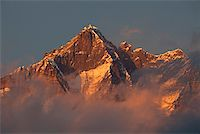 Nepal, Everest Region, Khumbu Valley. Shrouded in cloud on its lower slopes the peak of Mount Everest, known locally as Sagarmatha. Stock Photo - Premium Rights-Managednull, Code: 862-03731950