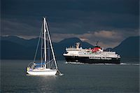 sailing boat storm - Scotland, Isle of Mull. A ferry passing a moored yacht in the Sound of Mull enroute to Tobermory on the Isle of Mull. Stock Photo - Premium Rights-Managednull, Code: 862-03732287