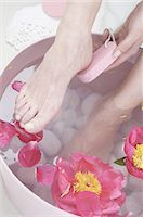 Woman taking footbath Stock Photo - Premium Royalty-Freenull, Code: 689-03733078