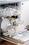 Dishes and cutlery in dishwasher Stock Photo - Premium Royalty-Free, Artist: Brad Wrobleski, Code: 689-03733441