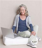 Senior woman using laptop Stock Photo - Premium Royalty-Freenull, Code: 689-03733673