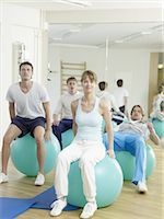 rehabilitation - Three men and a woman exercising with fitness balls Stock Photo - Premium Royalty-Freenull, Code: 689-03733760