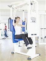 rehabilitation - Woman exercising at a health club Stock Photo - Premium Royalty-Freenull, Code: 689-03733762