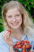Woman holding bowl with fruit Stock Photo - Premium Royalty-Freenull, Code: 689-03733801