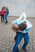 student fighting - Teenagers Fighting Stock Photo - Premium Royalty-Freenull, Code: 600-03734612