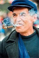 China, Guizhou Province, Qingman Miao village, a man smoking a pipe Stock Photo - Premium Rights-Managednull, Code: 862-03736543