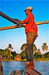 Kenya Mombasa. A boatman on one of the ferries that takes passengers to Funzi Island, off Kenyas south coast. Stock Photo - Premium Rights-Managed, Artist: AWL Images, Code: 862-03736803