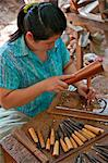 Thailand. A Thai woman carving wood in a workshop near Damnern Saduak, 80 km southwest of Bangkok. Stock Photo - Premium Rights-Managed, Artist: AWL Images, Code: 862-03737228