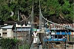 Woman Crossing Suspension Bridge, Syange Village, Marsyangdi River Valley, Annapurna Conservation Area, Gandaki Zone, Pashchimanchal, Nepal Stock Photo - Premium Rights-Managed, Artist: Jochen Schlenker, Code: 700-03737555