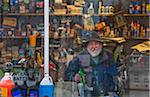 Man in Gas Station Window, Maine, USA Stock Photo - Premium Rights-Managed, Artist: David Mendelsohn, Code: 700-03737674