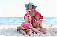 Mother with Daughers Eating Watermelon on Beach Stock Photo - Premium Rights-Managednull, Code: 700-03739268