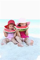 Sisters Eating Watermelon on Bridge Stock Photo - Premium Rights-Managednull, Code: 700-03739328