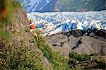 Woman rock climbing with Spencer Glacier in the background, Chugach National Forest, Kenai Peninsula, Southcentral Alaska, Summer Stock Photo - Premium Rights-Managed, Artist: AlaskaStock, Code: 854-03739543