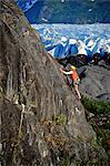Woman rock climbing with Spencer Glacier in the background, Chugach National Forest, Kenai Peninsula, Southcentral Alaska, Summer Stock Photo - Premium Rights-Managed, Artist: AlaskaStock, Code: 854-03739545
