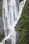 Ribbon-like waterfall cascades into Endicott Arm Fjord in Tracy Arm-Fords Terror Wilderness, Tongass National Forest,  Inside Passage of Southeast Alaska, Summer Stock Photo - Premium Rights-Managed, Artist: AlaskaStock, Code: 854-03739690