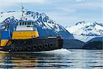 A tug pulling a barge cruises through the Inside Passage on its way south from Skagway, Alaska. Lynn Canal, Alaska Marine Lines. Stock Photo - Premium Rights-Managed, Artist: AlaskaStock, Code: 854-03739857