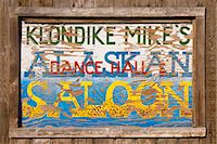 saloon - Close up of a sign for Klondike Mike's Alaskan Saloon, Palmer, Southcentral Alaska, Summer. Digitally altered Stock Photo - Premium Rights-Managednull, Code: 854-03739898