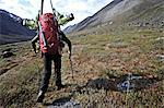 Backcountry skier hikes up the Katak Creek valley with pack and skis, Brooks Range, ANWR, Arctic Alaska, Summer Stock Photo - Premium Rights-Managed, Artist: AlaskaStock, Code: 854-03740029