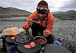 Backpacker prepares food base camp along the Hulahula River, Brooks Range, ANWR, Arctic Alaska, Summer Stock Photo - Premium Rights-Managed, Artist: AlaskaStock, Code: 854-03740050