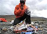 Backpacker eats snacks  at base camp along the Hulahula River, Brooks Range, ANWR, Arctic Alaska, Summer Stock Photo - Premium Rights-Managed, Artist: AlaskaStock, Code: 854-03740051
