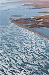 Aerial view of an oil well drilling platform on the tundra at the edge of the Beaufort Sea, Arctic Alaska, Summer Stock Photo - Premium Rights-Managed, Artist: AlaskaStock, Code: 854-03740252