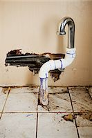 Damaged sink pipe Stock Photo - Premium Royalty-Freenull, Code: 614-03747700