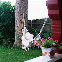 A hammock in a garden. Stock Photo - Premium Royalty-Freenull, Code: 6102-03748042
