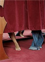The feet of a girl trying on jeans in a fitting room. Stock Photo - Premium Royalty-Freenull, Code: 6102-03750348