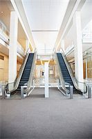 Escalators in modern office building Stock Photo - Premium Royalty-Freenull, Code: 635-03752180