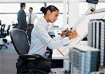 Architect drawing blueprint in office Stock Photo - Premium Royalty-Freenull, Code: 635-03752294