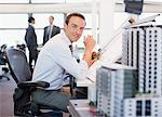 Businessman drawing on drafting table in office Stock Photo - Premium Royalty-Freenull, Code: 635-03752410