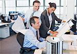 Business people reviewing blueprints in office Stock Photo - Premium Royalty-Free, Artist: Cusp and Flirt, Code: 635-03752421