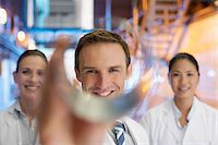 Scientists holding cylinder in factory Stock Photo - Premium Royalty-Freenull, Code: 635-03752456