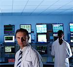 Scientists monitoring computers in control room Stock Photo - Premium Royalty-Freenull, Code: 635-03752467