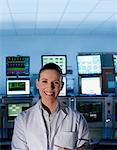 Scientist smiling in control room Stock Photo - Premium Royalty-Freenull, Code: 635-03752490