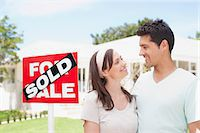 sold sign - Couple standing near sold sign of their new house Stock Photo - Premium Royalty-Freenull, Code: 635-03752507