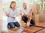 Couple unpacking boxes in new house Stock Photo - Premium Royalty-Freenull, Code: 635-03752508