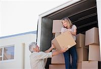 side view tractor trailer truck - Couple unloading boxes from moving van Stock Photo - Premium Royalty-Freenull, Code: 635-03752514