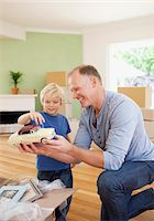 Father showing son model car in new house Stock Photo - Premium Royalty-Freenull, Code: 635-03752574