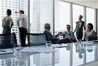 Business people working together in conference room Stock Photo - Premium Royalty-Freenull, Code: 635-03752829