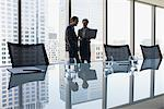 Business people working together in conference room Stock Photo - Premium Royalty-Freenull, Code: 635-03752868
