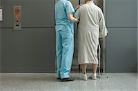 Nurse helping patient wait for elevator in hospital corridor Stock Photo - Premium Royalty-Freenull, Code: 632-03754365
