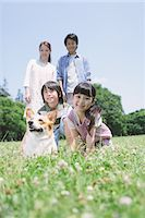 Cute Girl Enjoying With Her Family Stock Photo - Premium Rights-Managednull, Code: 859-03755340